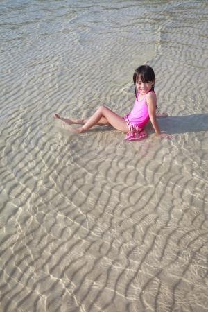 Little girl at the beach photo