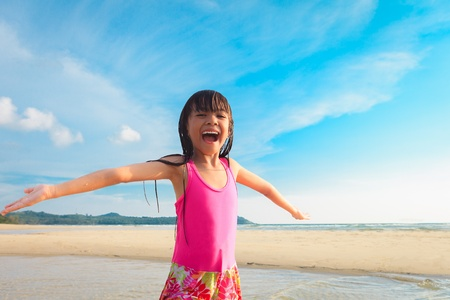 Happy smiling little girl on beach Stock Photo - 13373583