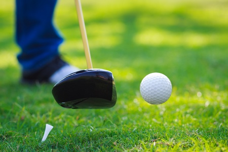 color range: Golf ball hit off the tee with driver on golf course