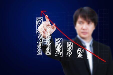Businessman hand touch virtual graph,chart, diagram photo