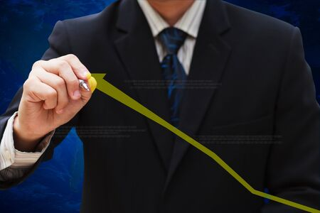 businessman hand drawing business graph photo