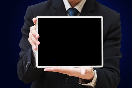 Businessman holding digital tablet pc with blank screen Stock Photo - 13487398