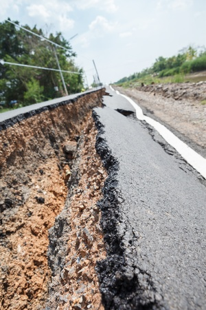 Cracked asphalt road after flood photo