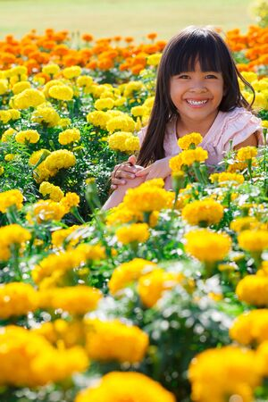 Smiling little girl on the meadow Stock Photo - 13653297