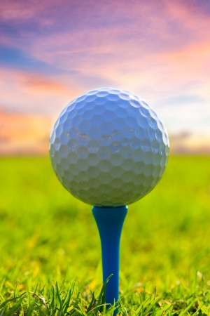 play golf: Golf ball on tee  Green grass