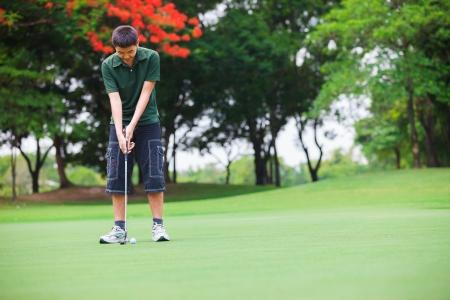 golfing: Golf teenager boy player green putting