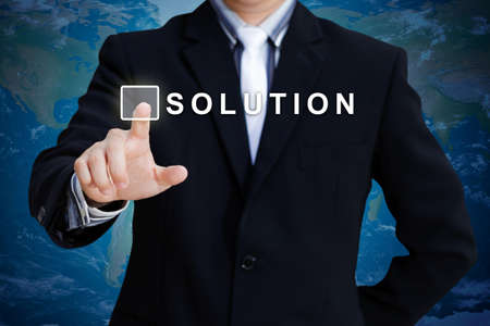 Businessman hand pushing solution button photo