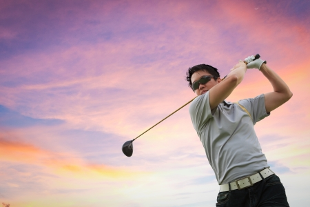 golf swings: Golfer shooting a golf ball, Twilight Sky Stock Photo