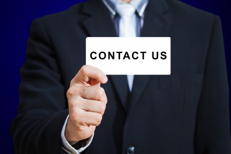 Businessman hand show contact us card Stock Photo - 13927423