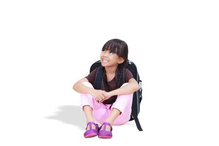 sitting down: Smiling little girl sitting down on floor
