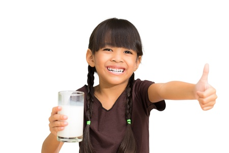 Smiling little girl with a glass of milk, Isolated on white photo