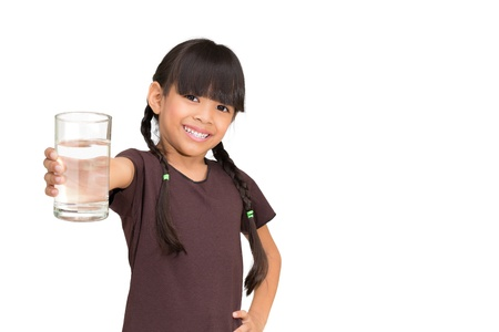 asia children: Smiling little girl with a water glass on white background Stock Photo