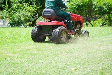 Lawnmower cutting overgrown grass photo