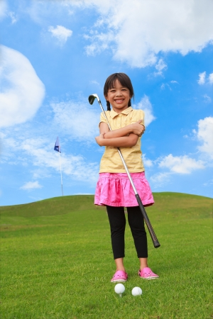 kids club: Smiling little girl at golf club