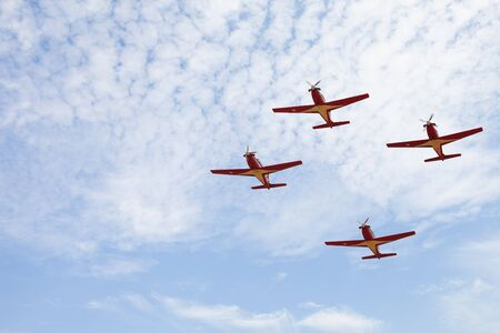 monoplane: Four airplanes in formation on airshow Editorial
