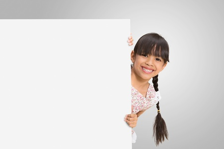 Little girl looking out of the blank sheet of paper Stock Photo - 14343444