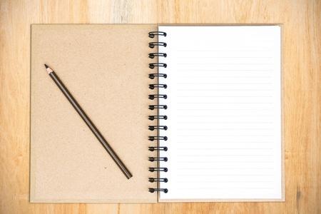 White notebook on wood photo