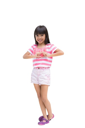 Little girl making the heart with her hands, Isolated on white with clipping path Stock Photo