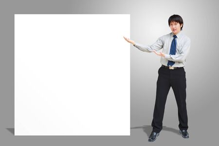 Asian business man showing blank signboard Stock Photo - 14719438