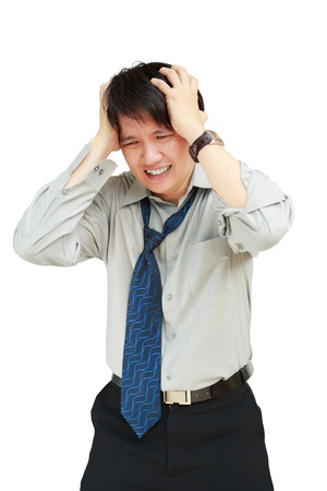 Young business man holding his head in pain against, Isolated on white photo