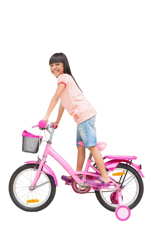 sincere girl: Asian little girl on bicycle, Isolated on white