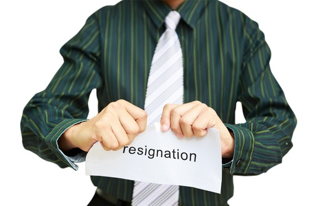resignation: A business man tearing a resignation letter, Isolated on white Stock Photo