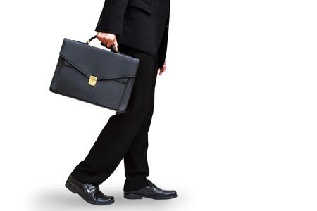 black briefcase: La secci�n inferior de la cartera de la mano del hombre de negocios la celebraci�n, aislado en blanco con saturaci�n camino