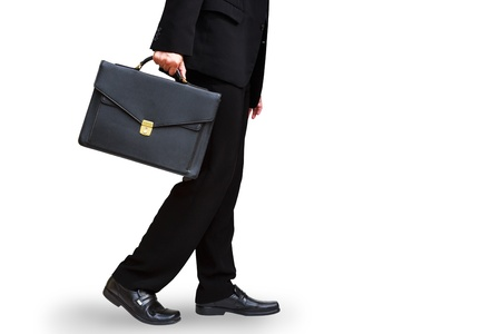 Lower section of business man hand holding briefcase, Isolated on white with clipping path photo
