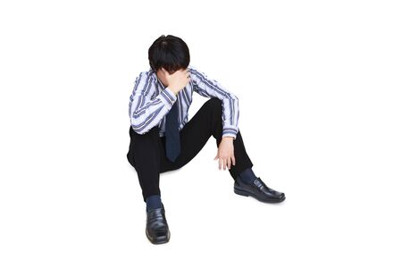 Portrait of sad businessman sitting on the floor photo