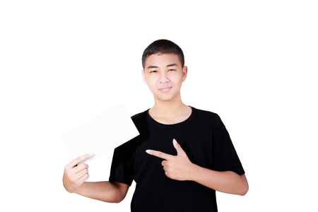 Portrait of a smiling teenage boy holding and pointing at a blank paper, Isolated on white Stock Photo - 15184255