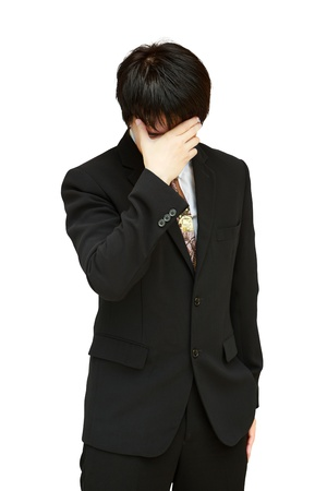 Young business man holding his head in pain   photo