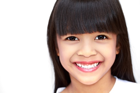 asian girl face: Closeup face of smiling little girl on white Stock Photo