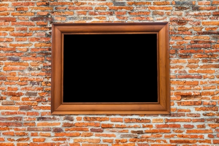 Wooden Photo Frame on Old brick wall Stock Photo - 15062694