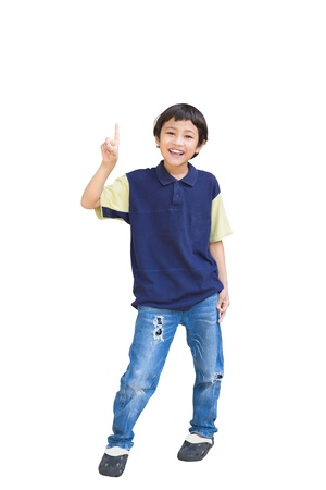 kid friendly: Cheerful little boy pointing up, Isolated over white background