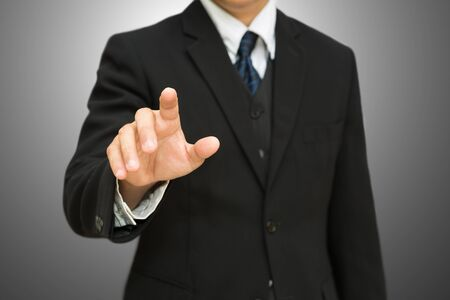 Businessman pushing on the whiteboard Stock Photo - 15174350