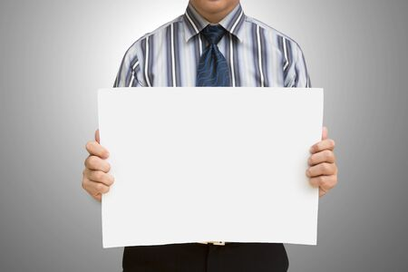 A business man holding blank paper  Stock Photo - 15174353
