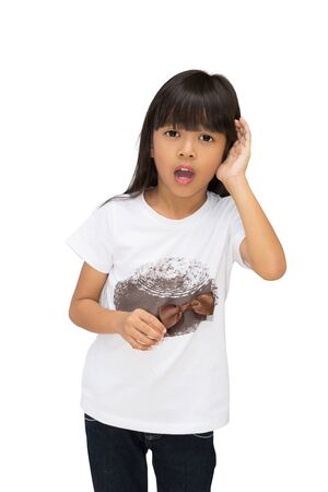 nape: Asian little girl holding her hand to her ear trying to hear you, isolated on white