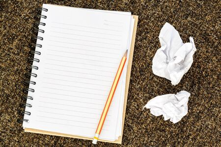 wads: Blank note book with crumpled paper