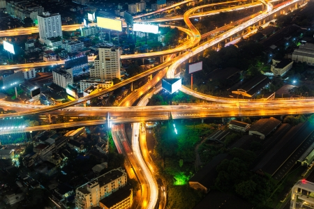 expressway: Closeup of highest Aerial view of Bangkok Highway Cityscape at Dusk in Thailand Stock Photo