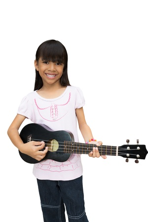 Beautiful little girl playing guitar, Isolated on white Stock Photo - 15250253