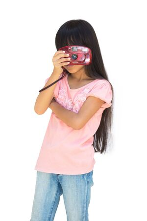 antique asian: Little girl with an old toy camera, Isolated on white