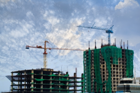 Building crane and building under construction against blue sky Stock Photo - 15467457