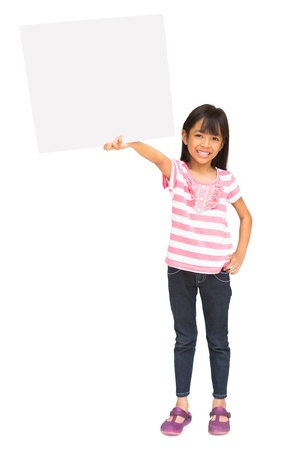 Smiling asian little girl holding blank sign, isolated on white photo