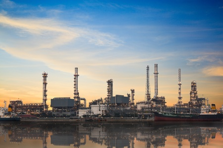 heavy industry: Refinery plant area at twilight with reflection Stock Photo