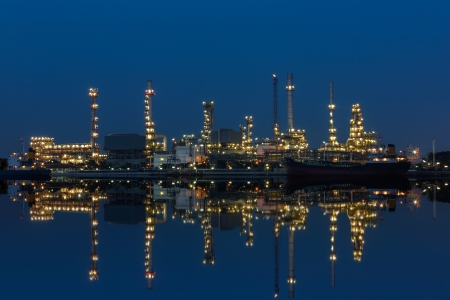 Nightview of Oil refinery factory with reflection photo