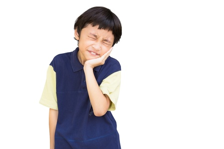 preteen asian: Asian little boy standing with his hand on his mouth suffering from a sore tooth,  Isolated over white