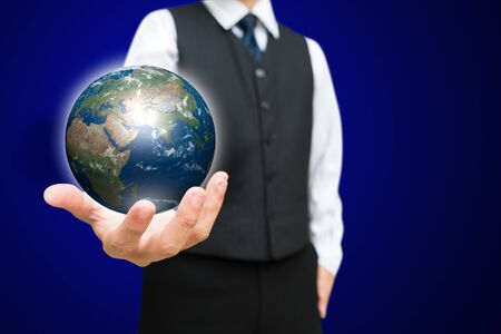 Business man with the digital globe ball on his hand, Elements of this image furnished by NASA Stock Photo - 15649480