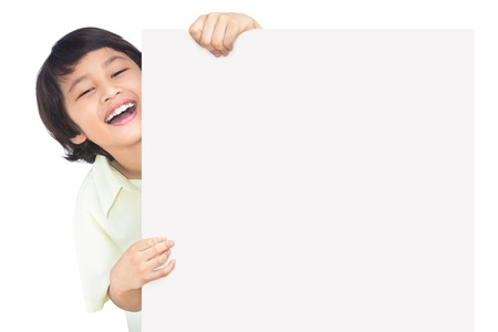 holding head: Happy boy with the empty blank, Isolated over white background Stock Photo
