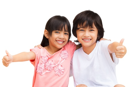 thai teen: 2 Child Making thumbs up with a Smile, Isolate on white