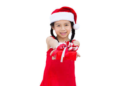 santa cap: Little girl with christmas gift, Isolated over white  Stock Photo